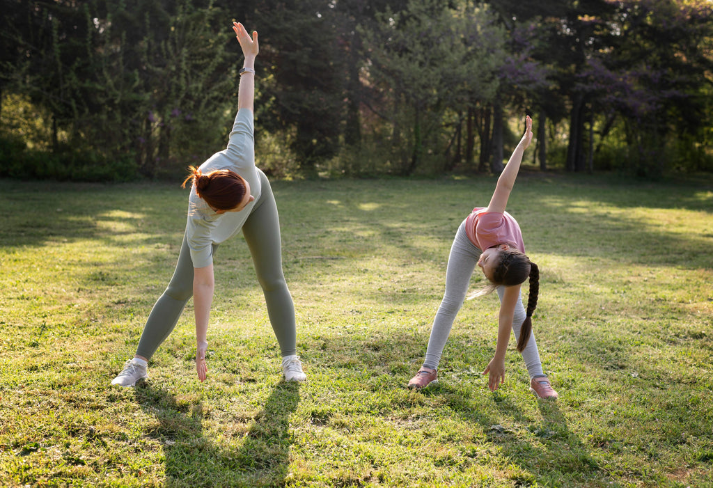 mother and daughter exercising outdoors