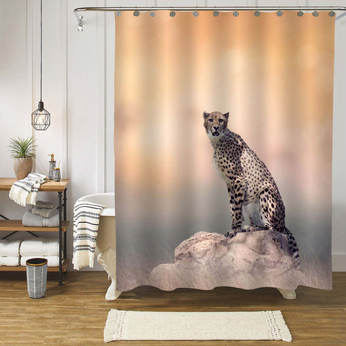 Young Cheetah Sitting on a Rock Shower Curtain - Gold