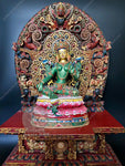 Green Tara on wooden throne