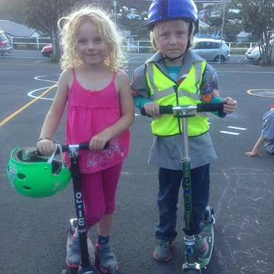 Kids learning scooter safety on their Micro Scooters