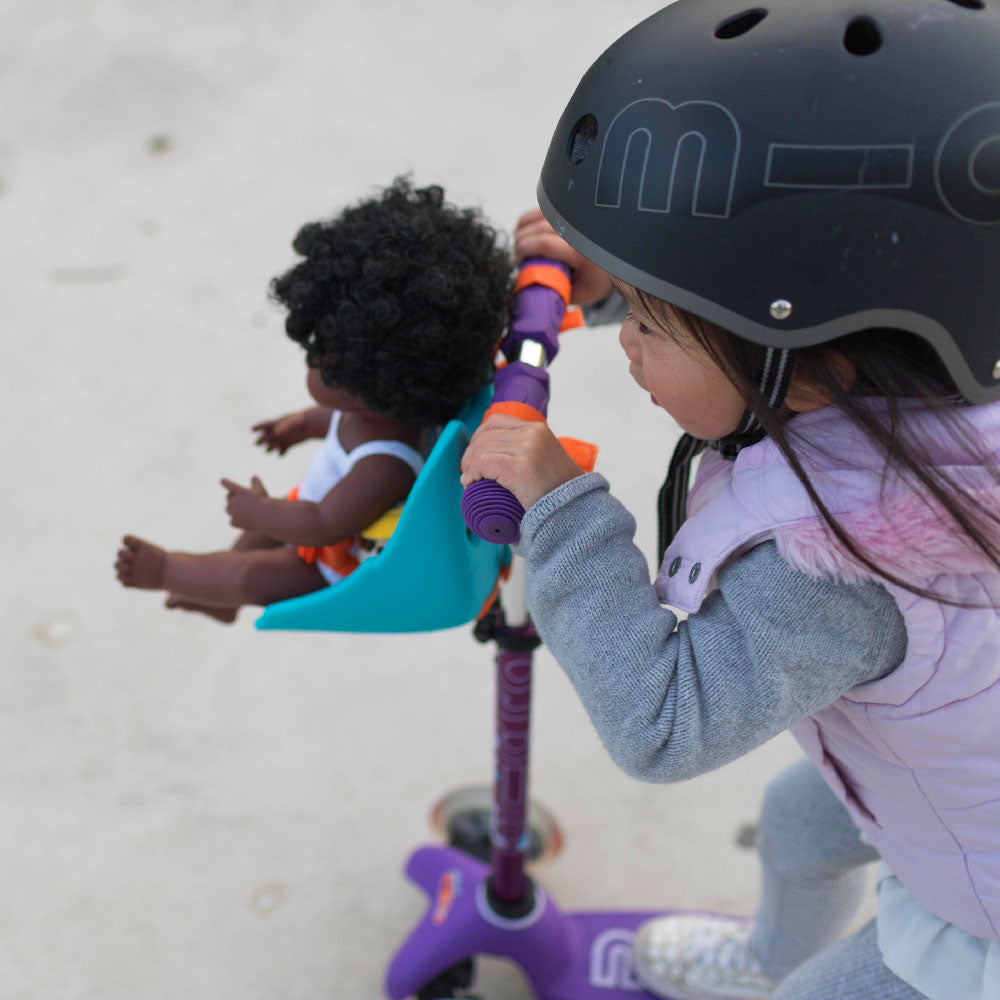 Toddler on her Mini Micro Deluxe with her Scootaseatz