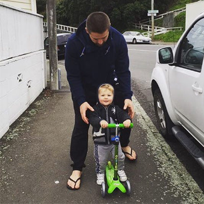 All Black Captain Scooting with his kids