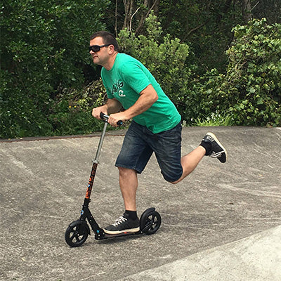NZ Mayor Scooting on Micro Classic
