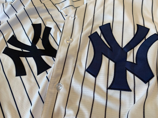 A licensed Yankees jersey vs. a fake Yankees jersey