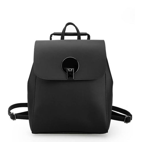 Small soft leather backpack features a zipper and overlap snap closure for added security.