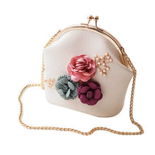 Load image into Gallery viewer, This ultra-feminine faux leather tote bag can be worn as a crossbody or a traditional shoulder purse. It features cute flower embellishments and a clutch closure.