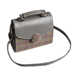 This chic small vintage-inspired handbag can class up any outfit. Can be worn as cross-body, traditional shoulder bag, or simply in your hand.