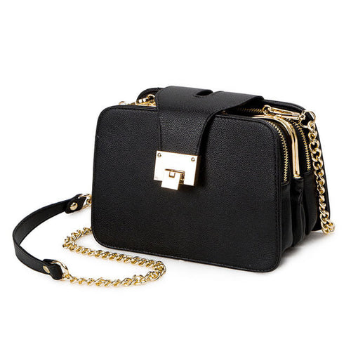 This edgy square purse is all the trend this fall. The gold, chain link strap can be worn as a crossbody or shoulder bag. It also features multiple zippers for easy organization.