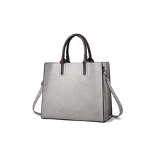 Load image into Gallery viewer, classic tote with a modern boxy design.