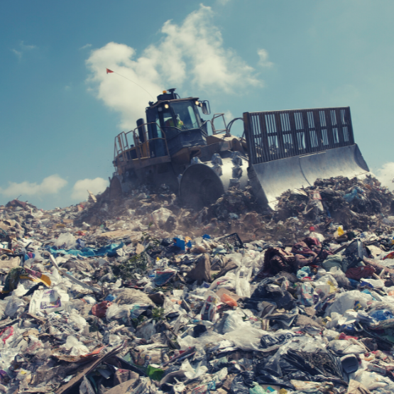 A bulldozer in a landfill