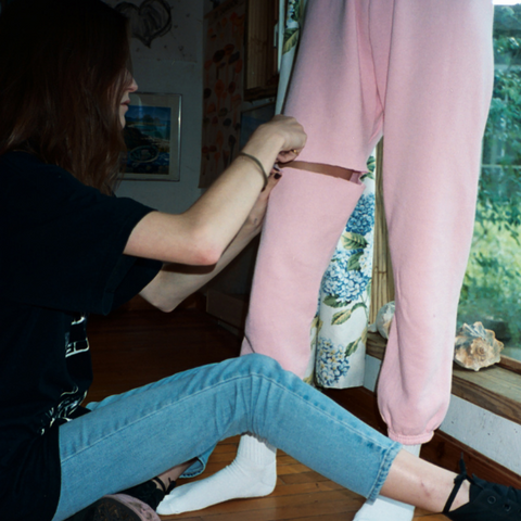 Cutting sweatpants for cropped upcycled shorts