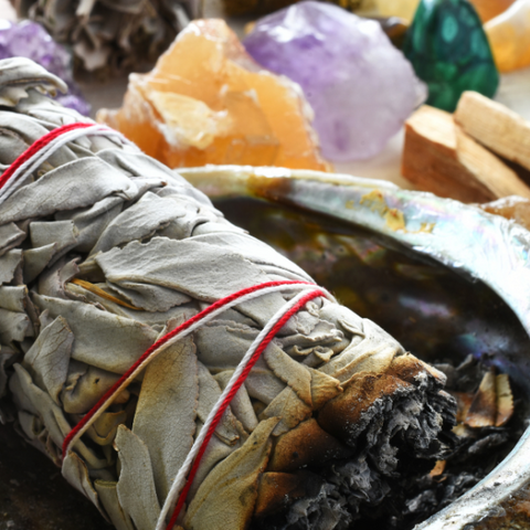 Burning sage near healing crystals to cleanse them