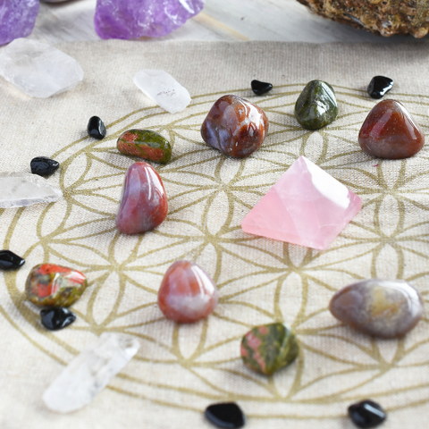 Different types of healing crystals organized in a circle on a table