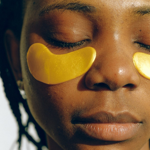 A woman with under eye masks on her face