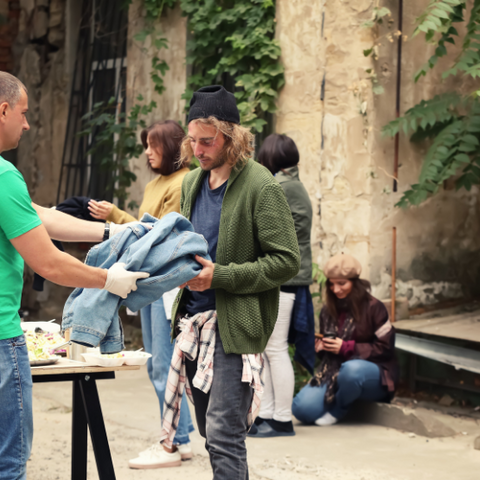 a man trading a piece of clothing from a table