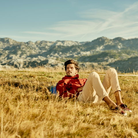 A man sitting on a romanticized mountain top