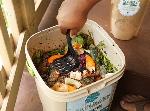 potato-masher-or-other-heavy-object-to-press-the-oxygen-out-bokashi-composting