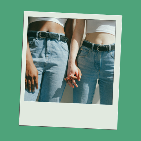 Gender neutral clothing on LGBTQ women holding hands