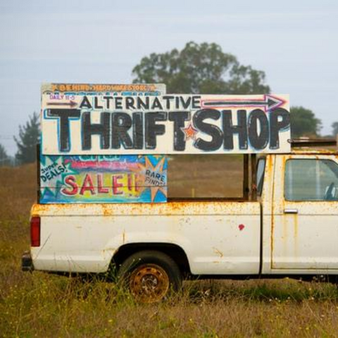 Truck with a thrift shop sign for shopping for reused clothing