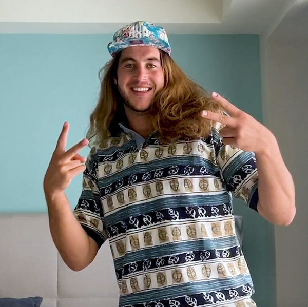 Bennet styles this crazy patterned Polo with a wild baseball cap for major surfer dude points