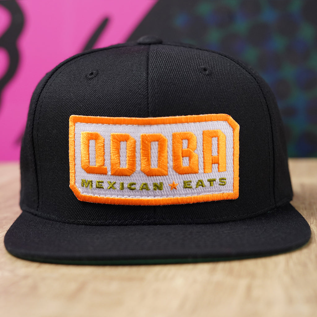 QDOBA MEXICAN EATS HAT