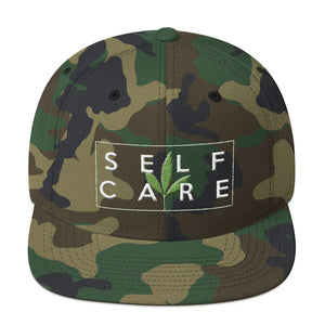 """ Self Care "" ( cannabis / white on camouflage ) Snapback Hat"