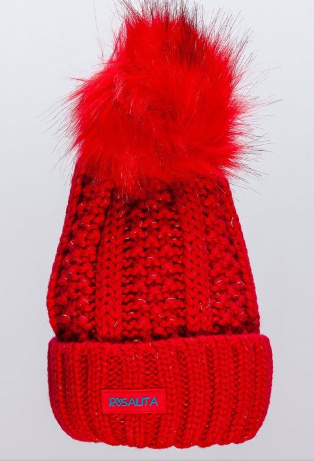 Rosalitas Brienz knitted hat with fixed faux fur pom pom.