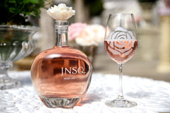 JNSQ Rosé Cru bottle with a rose wine glass