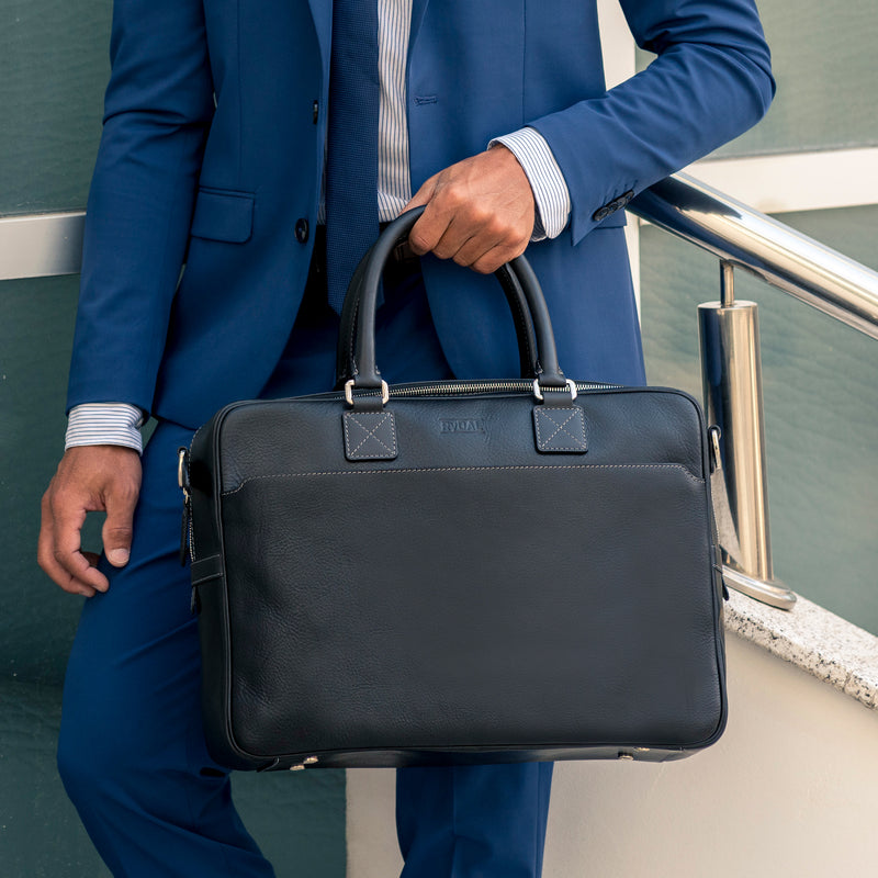 Model carrying Lexington Mens Leather Briefcase from Rydal in 'Black'.