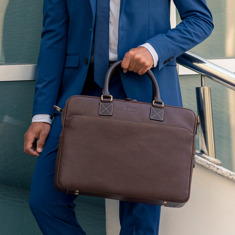 Model carrying Lexington Mens Leather Briefcase from Rydal in 'Dark Brown'.