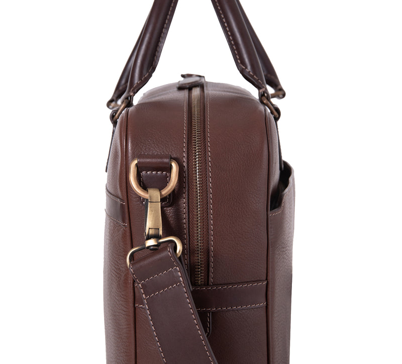 The Lexington Mens Leather Briefcase from Rydal in 'Dark Brown' showing close up of side of bag.
