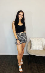 Floral Print Woven Shorts in Black & White with Tulip Hem