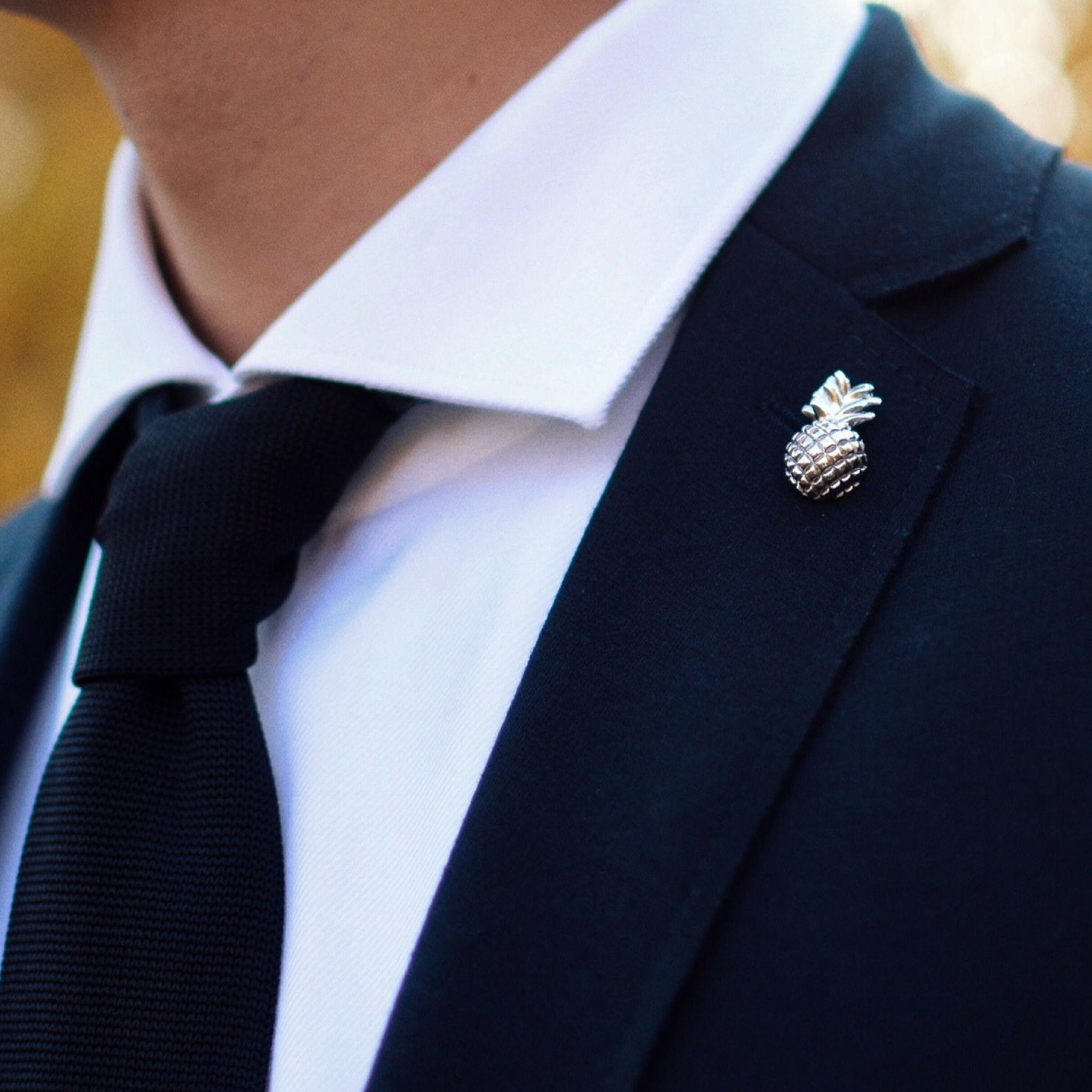 Lapel pin silver pineapple on a suit