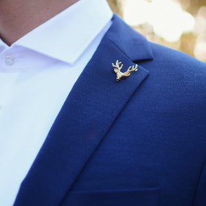 Lapel pin gold deer on a suit