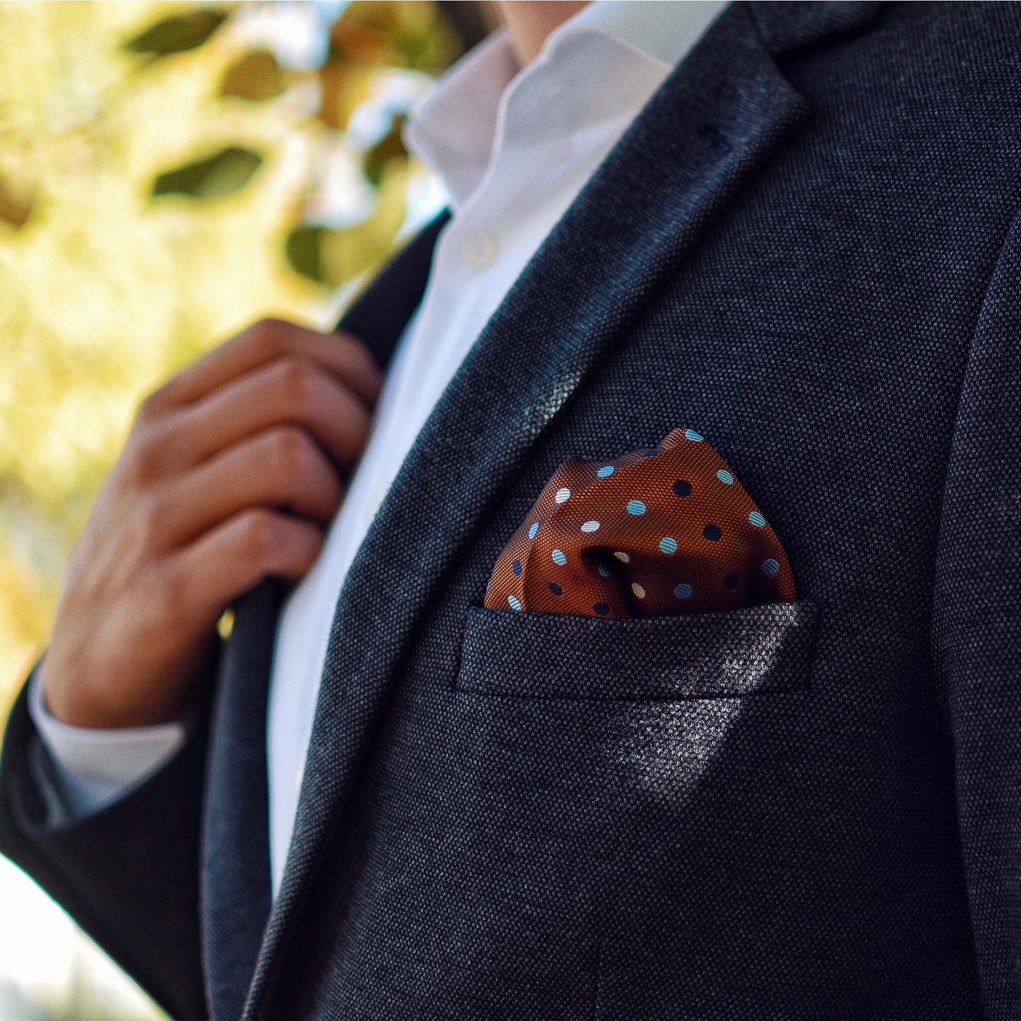 Brown pocket square on a suit