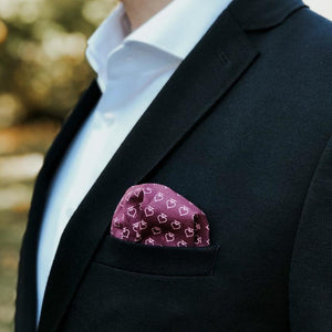 Red pocket square poker on a suit