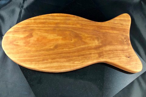 Fish shaped cherry wood cutting board