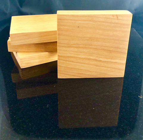 Set of 4 cherry wood coasters