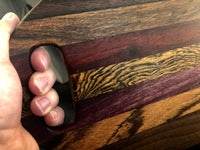 Oval Cutting Board with handle made with Walnut, Bubinga, Padauk, Bocote, and Purpleheart - A Good Turn Colorado