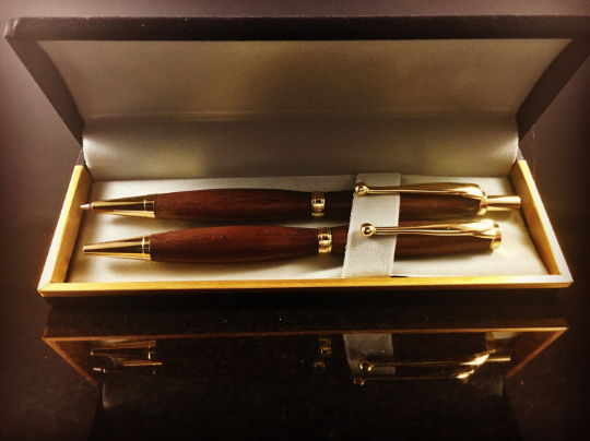 walnut and gold pen and pencil set
