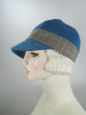 Women's fall and winter baseball style newsboy hat in teal blue and brown plaid