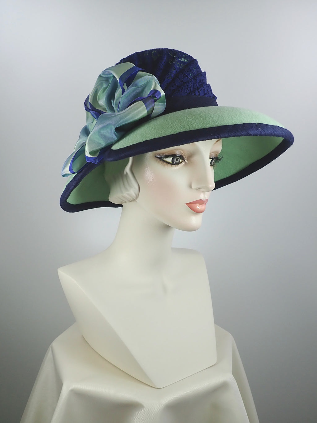 Dressy womens hat in navy lace and green wool felt