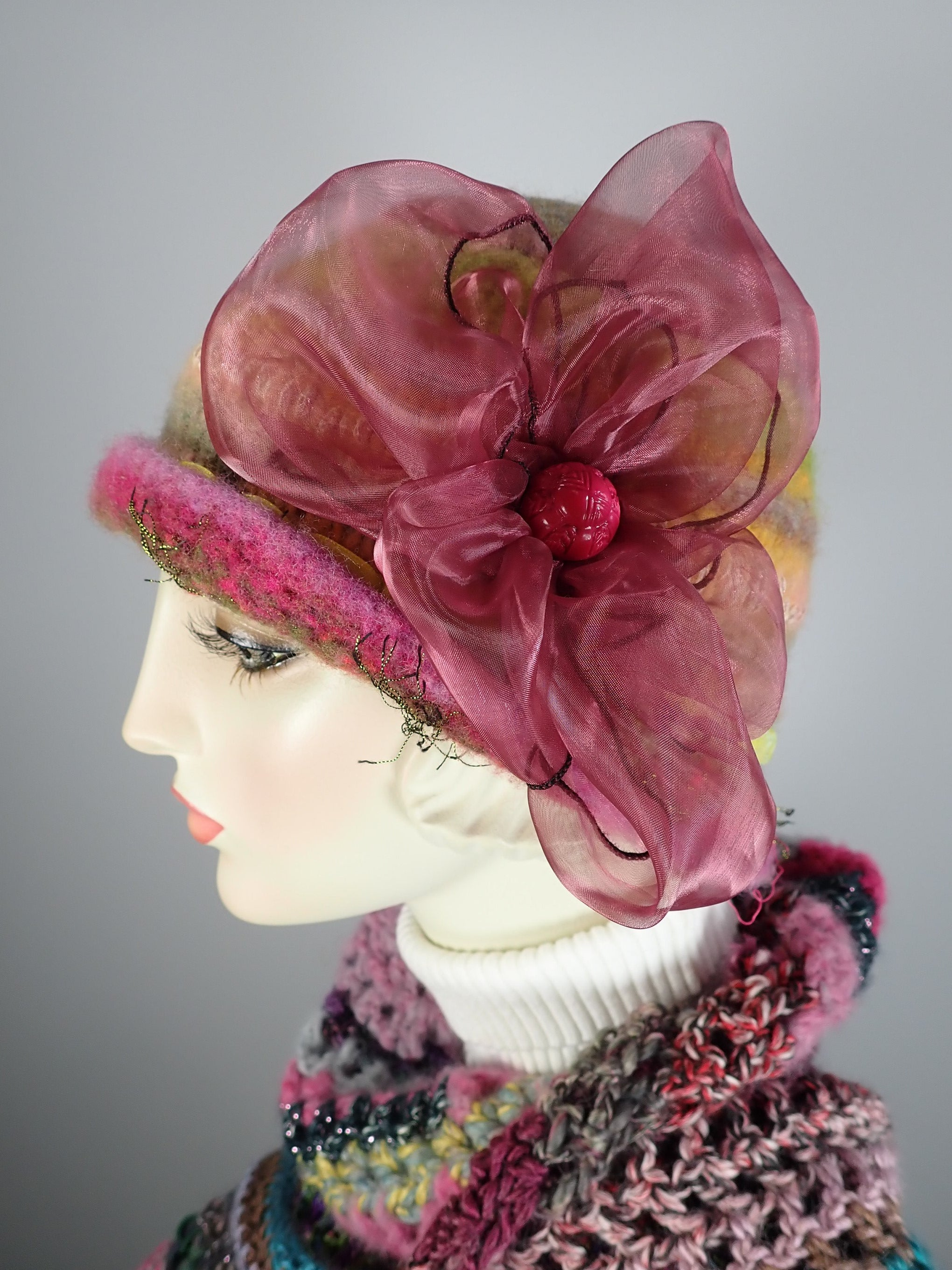 woolly flapped hats green and pink