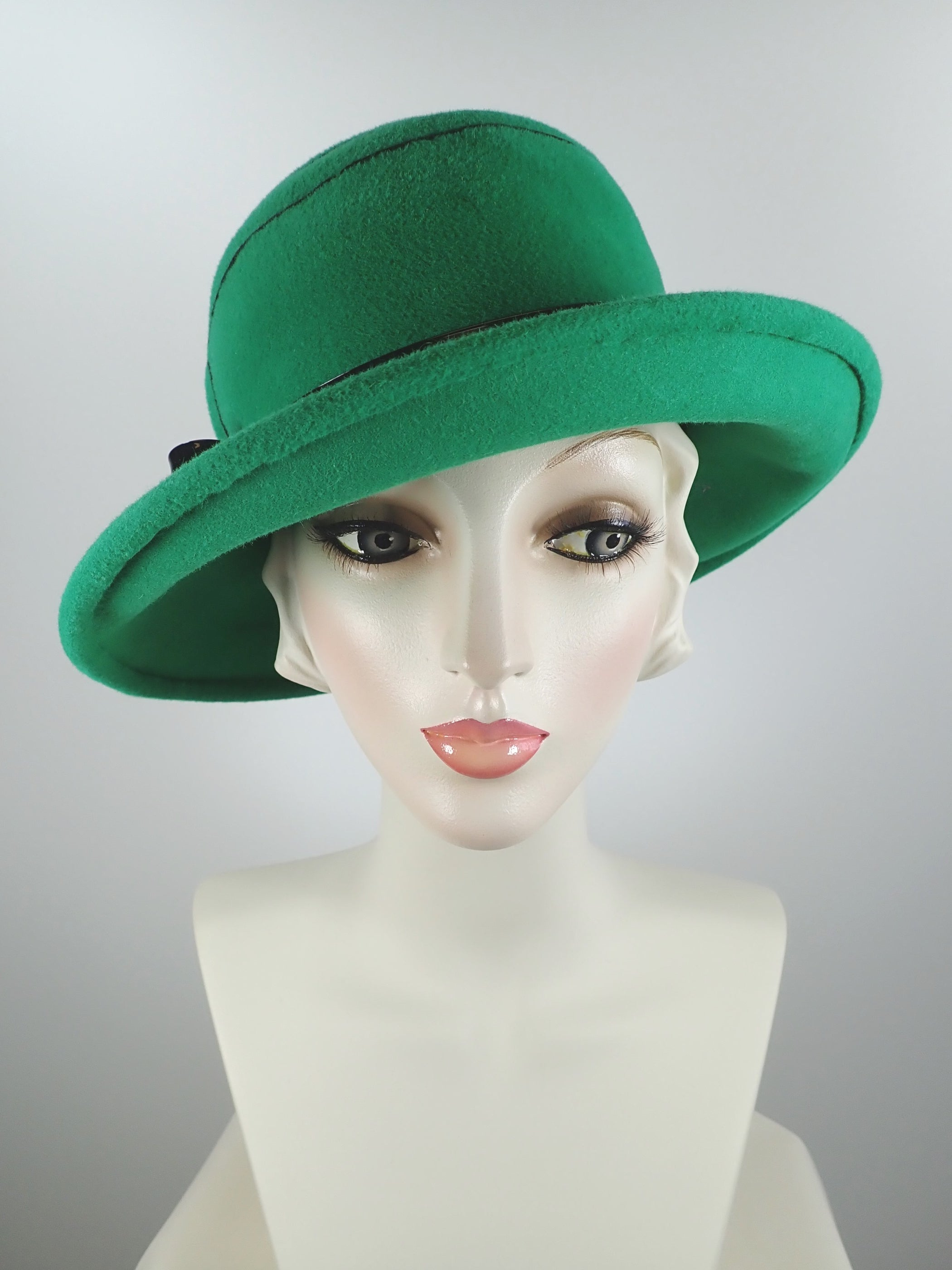 Green wool felt cloche hat with black embroidery and patent leather band