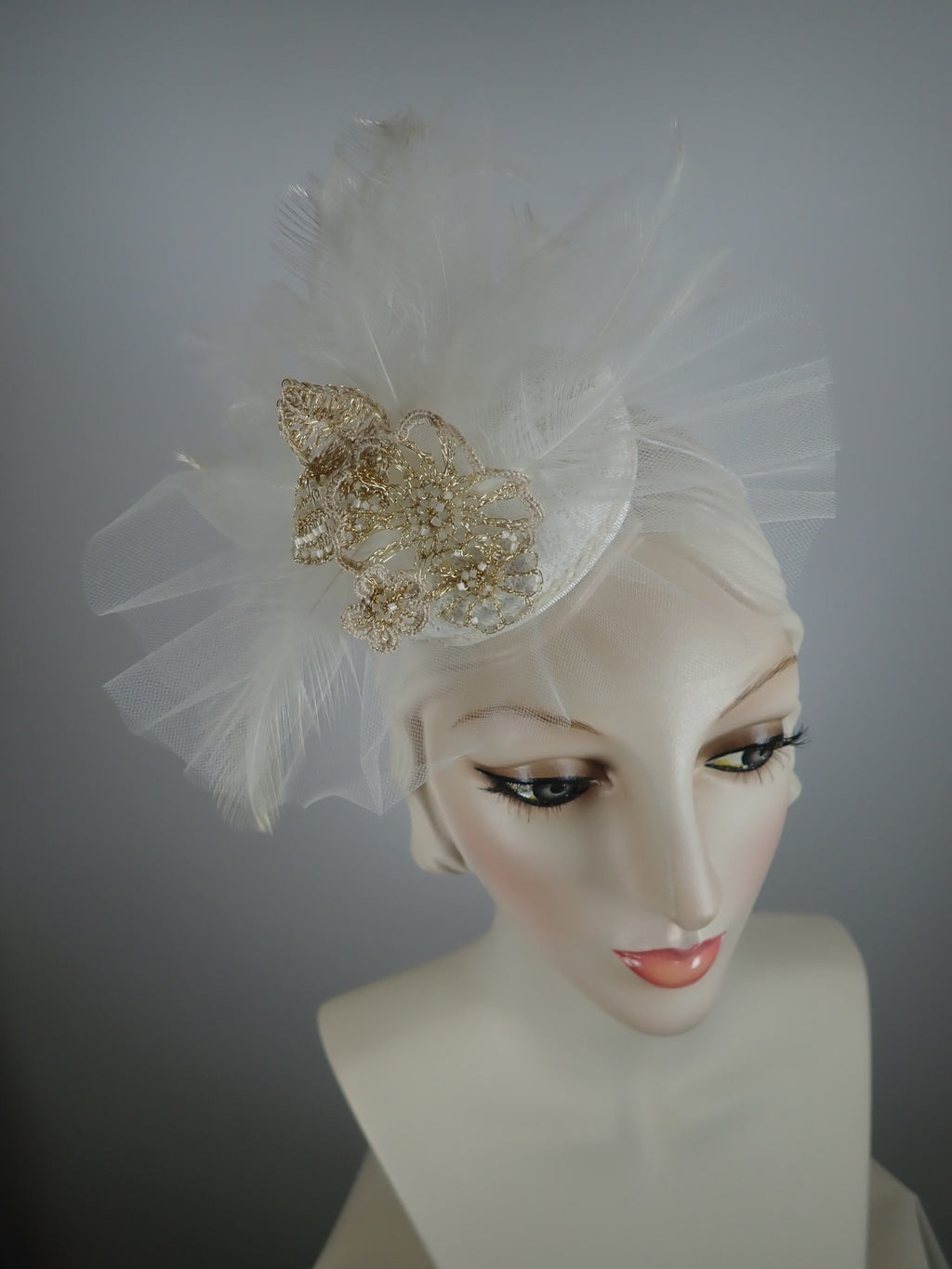 Off white bridal fascinator hat with hand crocheted bead and wire flowers