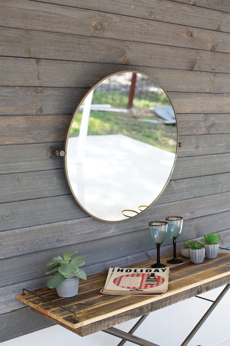 metal framed tilted round mirror