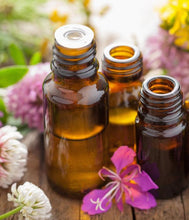 Aromatherapy oils surrounded by flowers