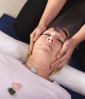 Woman experiencing crystal healing therapy