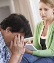 Empathetic counsellor with client experiencing stress
