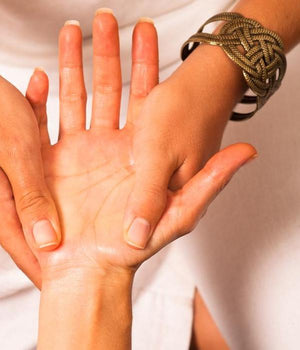 Hands of an Acupressure Practitioner